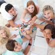 Teenagers studying Science on the floor - Stock Photo