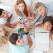 High angle of teenagers studying Science on the floor - Stock Photo
