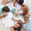 High angle of teenagers studying together — Stockfoto