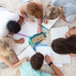Stock Photo: High angle of teenagers studying together