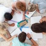 High angle of teenagers studying together — Stock Photo