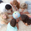High angle of teenagers on the floor examining a terrestrial wor — Stock Photo #10278338