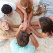 Teenagers lying on the floor with hands together — Stock Photo #10278354