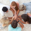 Teenagers lying on the floor with hands together — Stock Photo