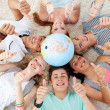 Teenagers on the floor with a terrestrial globe in the center an — Stock Photo #10278388