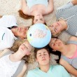 Royalty-Free Stock Photo: Teenagers sleeping on the floor with a terrestrial globe in the