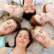 Teenagers with their heads together sleeping on the ground — Foto de Stock