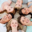 Friends with their heads together smiling — Stock Photo