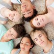 High angle of teenagers with their heads together sleeping on th — Stock Photo