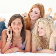Happy teen girls after shopping clothes talking on mobile phone — Stock Photo