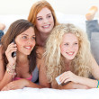 Happy teen girls after shopping clothes talking on phone - Stock Photo