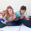 Boy and girl playing video games — Stock Photo #10278543