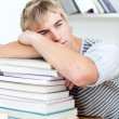 Tired teeenager sleeping in a library — Stock Photo