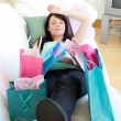 Pretty woman relaxing after shopping — Foto Stock