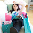 Pretty woman relaxing after shopping — ストック写真