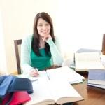 Smiling teen girl studying — Stock Photo
