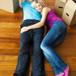 Stock Photo: Couple lying on the floor. Moving house