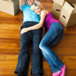 Happy couple relaxing on the floor. Moving house — Stock Photo