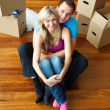 High angle of a couple sitting on floor. Moving house — Stock Photo #10279480