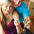 Happy couple celebrating new house with champagne — Stock Photo