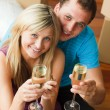Stock Photo: High angle of a happy couple celebrating new house with champagn