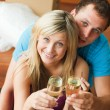 Stock Photo: Lovers celebrating new house with champagne