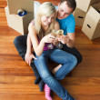 Happy couple celebrating new apartment with champagne — Stock Photo #10279493