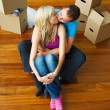 Couple moving to new house and kissing each other — Stock Photo
