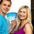Couple with colour samples to paint new house — Stock Photo