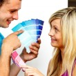 Couple with colour samples to paint new apartment. Concept of de — Stock Photo #10279507