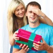 Woman giving a present to her boyfriend — Stock Photo