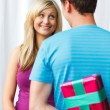 Man giving a present to a woman — Stock Photo