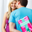 Boyfriend giving a present and a kiss to his girlfriend — Stock Photo #10279516