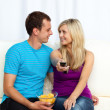 Lovers watching television and eating crisps — Stock Photo #10279552