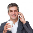 Confident Businessman on phone while drinking a coffee — Stock Photo