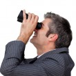 Visionary businessman looking through a pair of binoculars — Stock Photo