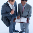 Businessmen writing in a business diary — Stock Photo
