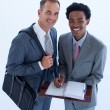Smiling businessmen writing in a business diary — Stock Photo
