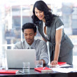 Businesswoman and businessman working in office — Stock Photo