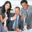 Business team with thumbs up in office — Stock Photo