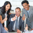 Happy businessteam with thumbs up in office — Stock Photo