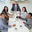 Business in a meeting smiling at the camera — Stock Photo #10279699