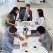 High angle of businessteam working in a meeting — Photo