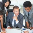 Multi-ethnic business working together in a project — Stock Photo #10279723