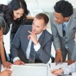 Businessteam talking about a project in office — Stock Photo #10279725