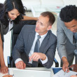 Businessteam working together in a business plan - Stock Photo