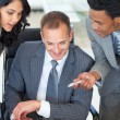 Manager with employees working in office — Stock Photo