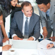 Manager and workers discussing in office a business plan — Stock Photo