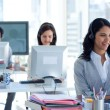 Businesswoman in a call center with her colleagues — Stock Photo #10279790