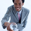 Smiling African businessman holding a glass of water — Stock Photo